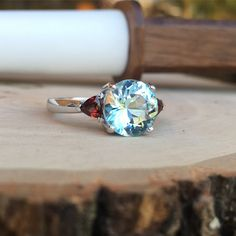 Ladies Custom Made Wedding Ring. Made in memory of our clients late husband. The Aquamarine & Garnet Represent their birthstones. #JewelerByDesign