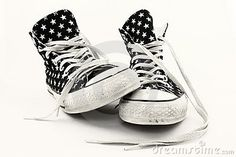 A pair of favorite old high-top tennis shoes worn with age and decorated with white stars. http://www.dreamstime.com/royalty-free-stock-photo-favorite-old-sneakers-rimage13497575-resi829263 #stockphotos #hightops #sneakers #blackandwhite #shoes
