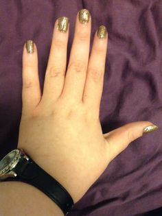 Brown nail polish with gold crackle - perfect for autumn