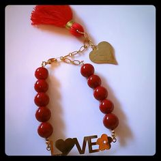 Mediterranean coral and fringe bracelet A statement piece, 18k gold plated. The heart charm has the word LOVE written all over, tassels,  a statement piece, perfect as a Valentine's day present Jewelry Bracelets