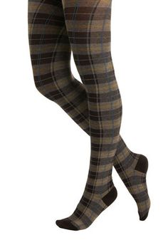 Modcloth Launch Plaid Tights  Composed of a comfortable cotton blend, these thick dark grey and black plaid tights, with splashes of yellow and cerulean blue color, are revved up with ravishingly flair. Sport this cool accessory with a button-up wool skirt, cute pullover sweater, and tortoiseshell specs before spending the day with your head in the clouds!