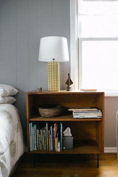 """Sneak Peek: Kristin & Michael Dekay. """"This little bookshelf serves double duty as a nightstand for our guest room. It was thrifted for 5 dollars, and has slim iron legs. The lamp was thrifted also, and I painted it a metallic gold."""" #sneakpeek"""