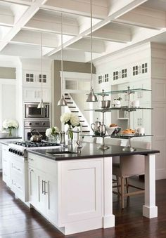 grey counters white cabinets wood floors - Google Search