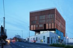 wood louvers wrap mantois technology center by badia berger in france