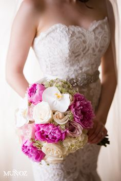 Boca By Design. Bouquet with White roses, purple peonies and white orchids.