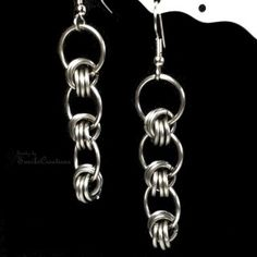 These stainless steel chainmaille earrings sports our version of Love Knots. Three 18 gauge rings are woven through 3 other rings.  Simple yet classy and is perfect for everyday occassions    Width: 13mm  Length from top of earwire: 2.5-inch (6.0cm)