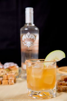 Caramel Apple Pie with 1 oz Smirnoff Kissed Caramel Flavored Vodka, .5 oz Captain Morgan Black Spiced Rum, 1 oz Apple Cider, .25 oz Lemon Juice, .25 oz Simple Syrup, 3 tsp Sugar, and 1 tsp Pumpkin Pie Spice. Use pumpkin pie spice to rim glass; combine liquid ingredients into an ice-filled shaker. Shake then strain into the rimmed glass. Garnish with a fresh apple slice if desired. #Smirnoff #drink #recipe #fall #thanksgiving #applecider #caramel #dessert