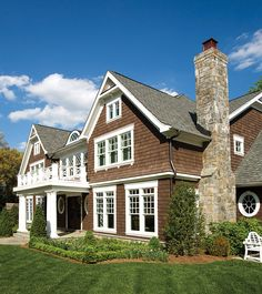 A custom Nantucket-style home in Arlington features a shingled exterior and a stone chimney. Stone Chimney, Chimney Cap, Nantucket Style Homes, Modern Family Rooms, Luxury Estate, Top Designers, Large Windows, Model Homes, Estate Homes