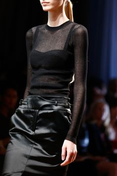 Jason wu. I love everything.  All black, sheer top and edgy leather skirt with intricate accents in the waist