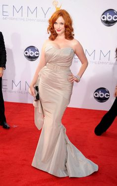 Emmys 2012: The Best of the Red Carpet - Christina Hendricks shows off her decolletage in a belted gown by Christian Siriano.