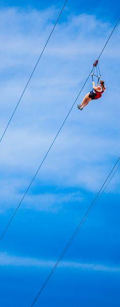 Soar down the world's longest zip line over water. The Dragon's Breath Flight Line in Labadee provides breathtaking views as you zip down 2,600 feet of flight line.
