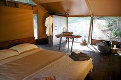high-end #safaritent  #glamping @ #nightfallwildernesscamp #queensland #australia  - king beds, #organic #linen #vintage #tinbath #stonehandbasin rotating #woodfire #organicfood