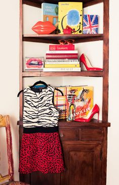 Inside Fashion Stylist Sophie Lopez's Closet: Lips Bag and British Flag Bag by Lulu Guiness, Giuseppe Zanotti, and Jimmy Choo, Black, White and Red Animal Print Dress by Fausto Puglisi, Red Pointy Toe High Heels by Brian Atwood | coveteur.com