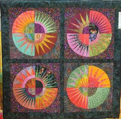 """4 square in N.Y. Beauty, 41 x 41"""", by Nancy Bourns.  2013 DVQG, photo by Quilt Inspiration"""