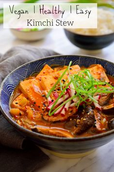 This vegan kimchi stew is quick and easy to prepare, packed with flavour and as spicy as you want it to be. Served with sliced tofu, shiitake mushrooms and rice on the side, it's a full and hearty meal that can be prepared in less than 30 minutes. Vegan Cabbage Recipes, Vegetarian Recipes, Healthy Recipes, Korean Recipes, Vegan Soups, Healthy Food, Cooking Recipes, Jjigae Recipe, Korean Food Kimchi