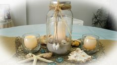 Sand Petal Weddings offers the convenient rental service of beach style centerpieces for ease to the traveling destination bride. Our numerous design style Nautical Wedding Centerpieces, Wedding Reception Centerpieces, Mason Jar Centerpieces, Centerpiece Ideas, Centrepieces, Mason Jars, Wedding Reception Games, Wedding Ideas, Wedding Themes