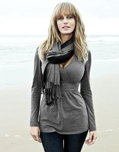 A comfy tunic-shaped jersey top with deep v-neckline and covered button detail.