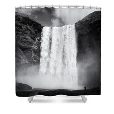 "Shower curtain: Skogafoss waterfall in Southern Iceland, black and white artwork with stark contrast for your bathroom decoration. This shower curtain is made from 100% polyester fabric and includes 12 holes at the top of the curtain for simple hanging. The total dimensions of the shower curtain are 71"" wide x 74"" tall. Matthias Hauser hauserfoto.com - Art for your Home Decor and Interior Design needs."