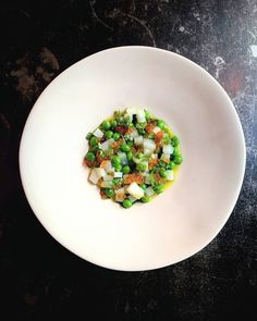Cuttlefish and green peas tartare, trout roe, chervil flower and vinaigrette at Septime in Paris. #regram from @septimeparis Tag your pics with both #lefooding and @lefooding and we'll regram our favorites!