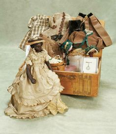 Doll although unidentified to date,circa 1865. - Theriault's Antique Doll Auctions - rare petite french brown complexioned poupee with trunk and trousseau... isn't she gorgeous!! and she's got everything she needs in that there trunk!! (even a chatelain!)  like Madame Susha - Purveyor of Opulence and All Things Fine.... seeker of beauty and pilferer of treasure trunks in old dusty attics!