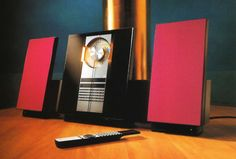 Bang & Olufsen Beosystem 2300 with angled face, colourful speaker cloth and horizontally sliding glass doors to access the CD player