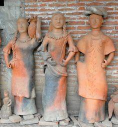 Three Women Oaxaca. These three lifesize clay women are the works of blind potter Jose Garcia Antonio of San Antonino Ocotlan, Oaxaca, Mexico. The figures represent women from three of the eight regions of the state of Oaxaca