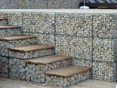 Gabion baskets are filled with rocks as steps and wall. Gabion baskets are filled with rocks as steps and wall. Gabion Retaining Wall, Landscaping Retaining Walls, Backyard Landscaping, Gabion Stone, Gabion Fence Ideas, Retaining Wall With Steps, Fence Design, Garden Design, House Design