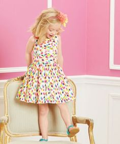 Dips, dabs, and dots cover this soft, playful dress.