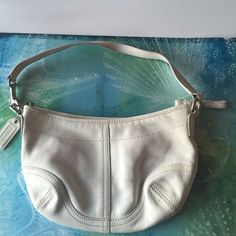 "COACH 100% authentic white leather hobo bag 100% authentic small white COACH leather hobo bag. It its pre-owned and is in GUC. Super cute to use as a ""Bar"" bag or even as a makeup case! No trades please.  Coach Bags Hobos"