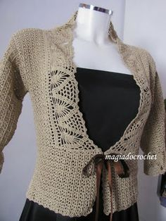 Repinning to try to link directly to the page with this sweater.  Unfortunately, the whole blog is in Portugese, so I suspect the patterns are, too.