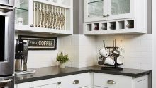 White Kitchen, subway tile, white tile, wine, serving area, dining, coffee nook, but first, coffee, coffee mug rack, wine storage, butlers pantry, plate rack, double oven, stainless steel, appliances, family kitchen, dark counter top, glass doors, open display, wine glasses, entertaining in your home