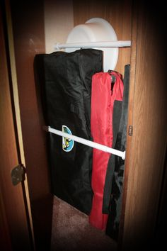 Use inexpensive spring tension rods to hold things in place in the closet and prevent them from moving around while driving. keep a couple of extra rods to use when needed for towel drying, etc.