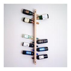 Wall-mounted wine rack. A fun Sunday DIY project.