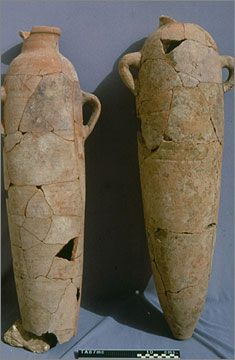 Two narrowly cylindrical amphorae made in 'oasis fabric' and so probably used to bring in wine from the western desert oases Amarna  Egypt
