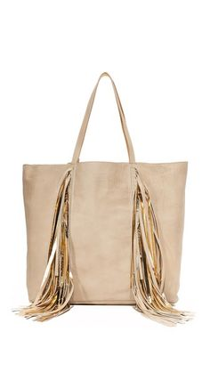 Swingy fringe punctuates the front of this slouchy Sara Battaglia tote. The metallic, unlined interior includes an optional zip pouch. Double handles. Dust bag included.