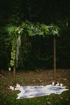 Rustic boho wedding arbour with draped green foliage and candles | Bonnie Jenkins