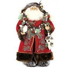 The Lighted Woodland Santa from Karen Didion Originals brings the joy of Christmas into your home. The quality of this figurine is unmatched with its hand-painted face, glass inset eyes, real mohair beard, unique fabric, and detailed accessories.