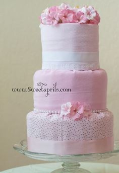 """A """"fondant-style"""" cake covered in little baby blankets. 