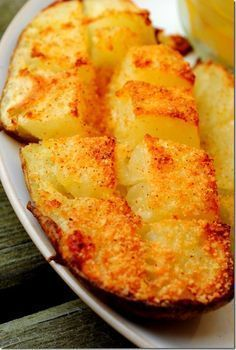 The most Ah-Mazing Roasted Potatoes!  These are so stinkin' easy to make!  Cook a pierced potato in the microwave for 6-7 mins. (flip every couple mins.) til soft all the way thru.  Cut in half, then into squares (just down to skin).  Season with butter, parmesan & Lawry's. Place in oven on aluminum foil-lined pan and BROIL for 10-15 mins.  Enjoy!!! - Click image to find more Food & Drink Pinterest pins