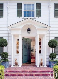 Lovely traditional entrance, Timothy Corrigan in Los Angeles. Brick steps leading up to classic white clapboard with beautifully detailed green front door and green shutters, perfectly proportioned. House Design, Colonial Style, House Styles, Colourful Shutters, Architectural Digest, Colonial Style Homes, Colonial House, Colonial Exterior, Brick Steps