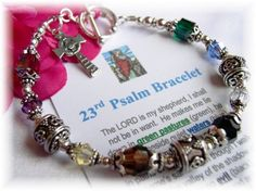 "Psalm 23 Bracelet Wear a precious reminder of the Lord's never-ending love with a beautiful ""23rd Psalm"" bracelet created with decorative sterling silver Bali beads and Swarovski crystals in colors that tell the story of the 23rd Psalm. What a unique conversation piece and beautiful way to share the story of Psalm 23.  Bracelet is accented by a beautiful sterling cross enscribed with ""The Lord is my Shepherd, I shall not want. Psalm 23"""