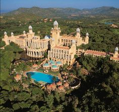 Palace of the Lost City: South Africa is home to one of the world& most extraordinary hotels. It offers an overload of African images and is totally over the top. The Lost City is make-believe, but the crocodiles around the golf course are the real thing. Sun City Hotel, Sun City Resort, City Golf, Bar Lounge, Sun City South Africa, Places To Travel, Places To Visit, Travel Destinations, Holiday Destinations