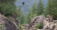 Watch A Crazy Mountain Biker Nail A Massive Railroad Tracks Jump