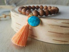 Check out this item in my Etsy shop https://www.etsy.com/listing/488982955/sandalwood-tassel-bracelet-with