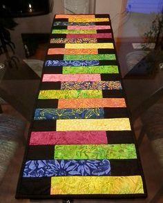 Batik quilted table runner in tropical colors, reversible to black and white…