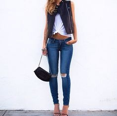 Distressed denim. Crop top. Leather moto vest. Single-sole sandals. Everything!