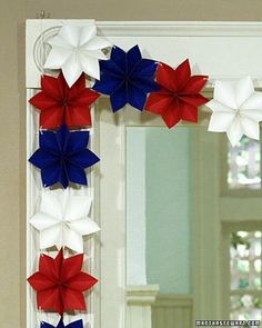 Fashioned from red, white, and blue paper stars, this festive garland adds a patriotic touch to a doorway or mantel. Easy and inexpensive to make, it's a great holiday project for both children and adults.