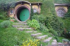 Hobbiton - it pleases my childhood love of nooks and clever spaces.  It's now in New Zealand, open for tours.  I'd love to go. . .