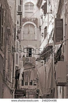Greece. Corfu (Kerkyra) island. A typical courtyard in the center of Corfu Town. Sepia - stock photo