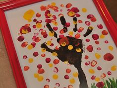 really cute fall art project for kids - hand print fall tree/branches & finger print fall leaves